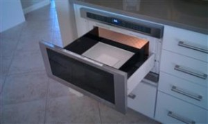 Easy access microwave drawer under cabinet